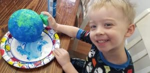 Earth Day with Jack painting an earth by the irish twins momma