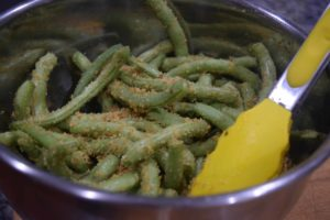 Well coated green beans with breadcrumbs