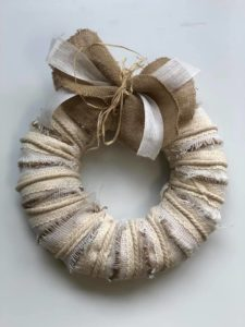 Beautiful wreath made with different types of natural burlap